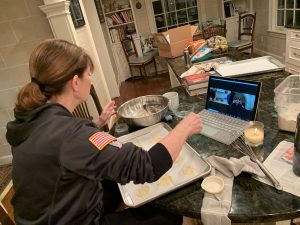 Jaclyn's mother teaching family how to cook appetizers over a Zoom video all